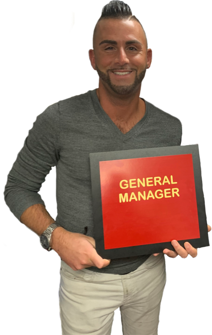 Chili's Team Member highlighting his career growth by holding up sign that reads 'General Manager'
